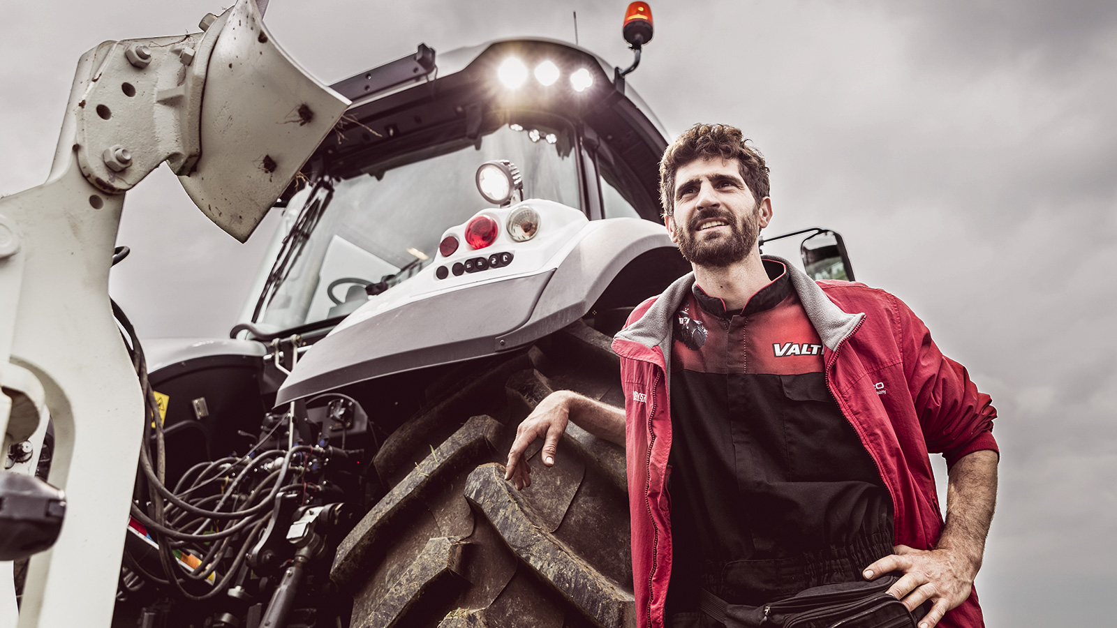 valtra tractor with man standing outside